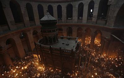 Orthodox Christian worshipers celebrate Easter at the Church of the Holy Sepulchre in Jerusalem's Old City during on May 4, 2013. (photo credit: Sliman Khader/Flash90).