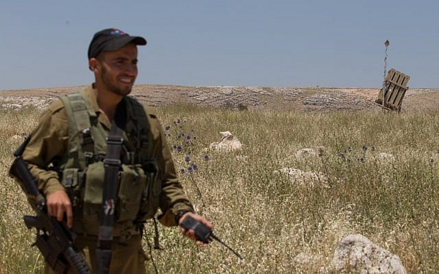 A soldier guarding an Iron Dome battery in the north of the country, May, 2013. (photo credit: Flash90)
