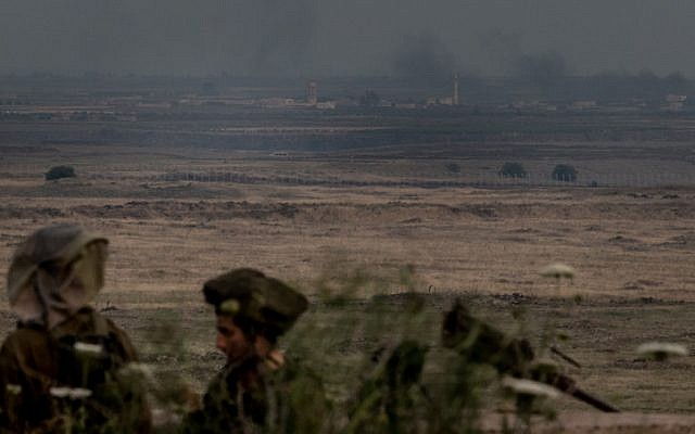 Israeli infantry soldiers on the Golan Heights, near the Syrian border, on the day after an early May strike in Damascus (Photo credit: Flash 90)