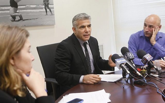 Finance Minister Yair Lapid leads a Yesh Atid party meeting in the Knesset. (photo credit: Miriam Alster/Flash90)