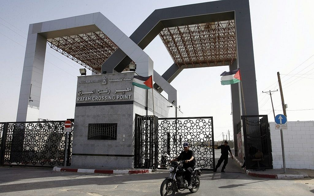 Hamas security forces stand guard at the closed gate of the Rafah crossing with Egypt in the southern Gaza Strip in May, 2013. (photo credit: Abed Rahim Khatib/Flash90)