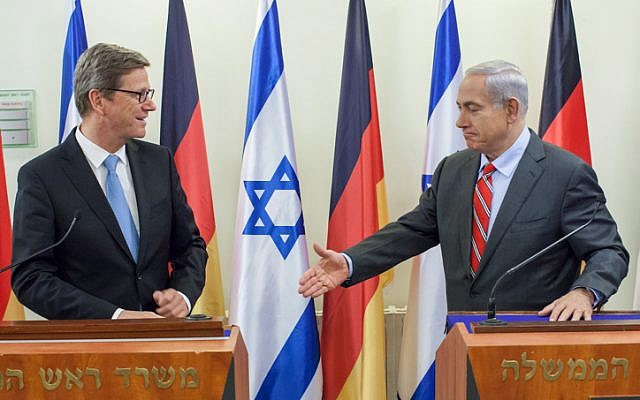 Prime Minister Benjamin Netanyahu extends his hand to German Foreign Minister Guido Westerwelle during a press conference after a meeting in Jerusalem, Friday, 17 May (photo credit:  Emil Salman/Flash90)