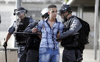 Illustrative photo of Israeli policemen detaining a Palestinian youth during a protest in Damascus Gate, Jerusalem in May 2013. (photo credit: Sliman Khader/Flash90)