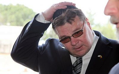Linas Linkevicius, the foreign minister of Lithuania, puts on a yarmulke as he enters the Hall of Remembrances in the Yad Vashem Holocaust Memorial in Jerusalem on May 19, 2013. (photo credit: Isaac Harari/Flash90)