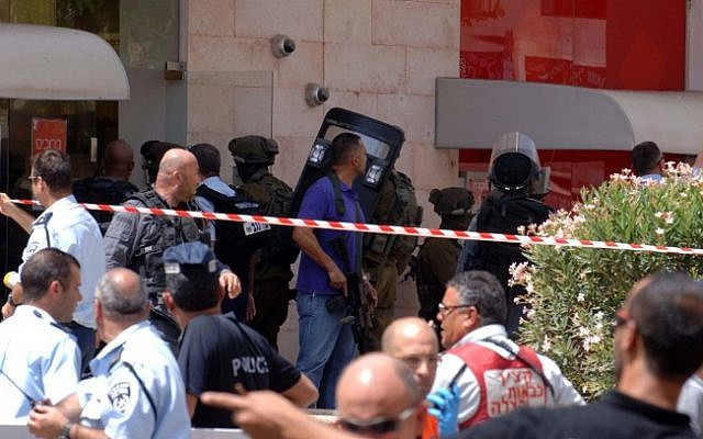 The crime scene outside the Bank Hapoalim in Beersheba where four people were killed by a local gunman on May 20, 2013. (photo credit: Dudu Greenspan/Flash90)