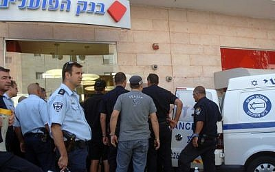 Security and rescue forces at the site of the Beersheba bank shooting, May 20 (photo credit: Greenspan/Flash90)