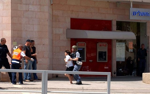 Miri Cohen, a bank employee, was released after being held hostage for over an hour Monday in Beersheba by a gunman who killed four victims at a local bank (photo credit: Dudu Greenspan/Flash 90)