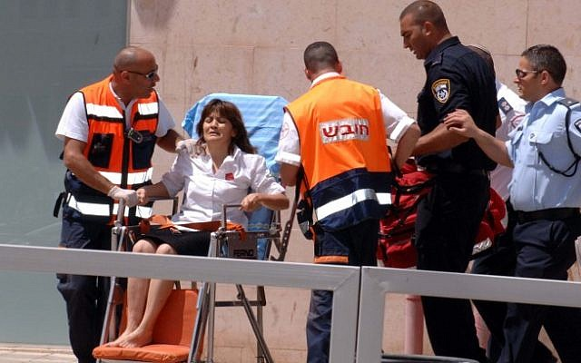 A woman was treated for shock and rushed to the hospital after she was held hostage by a gunman in a Beersheba bank, Monday, May 20 (photo credit: Dudu Greenspan/Flash90)