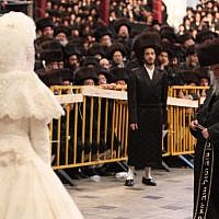Tens of thousands of Ultra-Orthodox Jews from the Belz Hassidic dynasty attend the wedding ceremony of Rabbi Shalom Rokach, the grandson of the Belz Rabbi, to Hana Batya Pener on May 22, 2013. (Photo credit: Yaakov Naumi/Flash90)