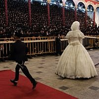 "The bride,  Hana Batya Pener, is entreated to a ""mitzvah tantz"" at her wedding to Rabbi Shalom Rokach, the grandson of the Belz Rabbi, on Tuesday. The dance is a highlight of the wedding ceremony, in which the bride holds one end of a sash while her father and other important men in the community dance on the other end. (Photo credit: Yaakov Naumi/Flash90)"