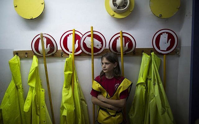 A schoolgirl waits in a shelter on Monday as an air raid siren sounds during an IDF Home Front Command drill simulating a bombing attack (photo credit: Yonatan Sindel/Flash90)