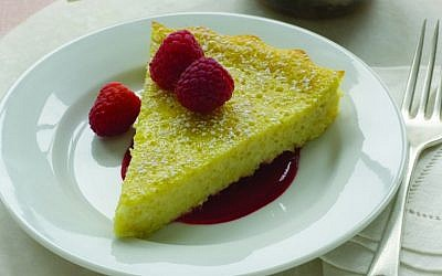 Ricotta Flan with Raspberry Sauce is a lighter alternative to the traditional Shavuot cheesecake. (photo credit: From 'Helen Nash's New Kosher Cuisine'/JTA)