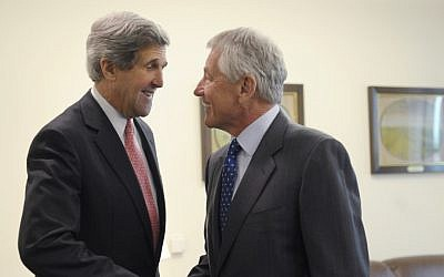 Defense Secretary Chuck Hagel, right, welcomes Secretary of State John Kerry, left, to his office at the Pentagon in Washington, Monday, May 6, 2013 (photo credit: AP/Susan Walsh)
