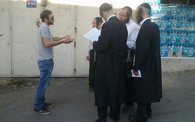 Illustrative: Anarchists and ultra-Orthodox men conversing in Jerusalem (photo credit: courtesy of Behadrei Haredim)