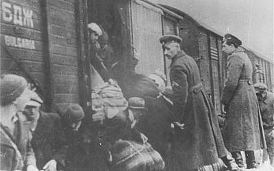 This image provided by the US Holocaust Memorial Museum shows Bulgarian policemen overseeing the deportation of Macedonian Jews to the German death camps in March 1943 in Bulgarian occupied Skopje. (AP Photo/U.S. Holocaust Memorial Museum, Courtesy of Jewish Historical Museum, Belgrade)