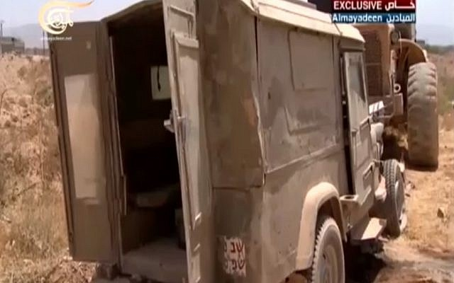 The jeep with IDF markings reportedly found during fighting in Qusair, Syria. (screenshot / al-Madayeen news channel)