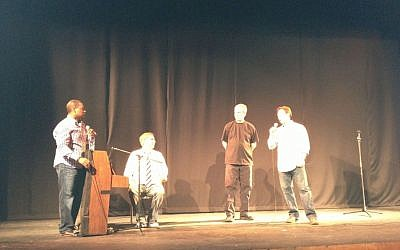 The four comedians of Comedy for Koby: Ralph Harris, Wayne Federman (seated), Dennis Regan and Avi Liberman (photo credit: Jessica Steinberg/Times of Israel)
