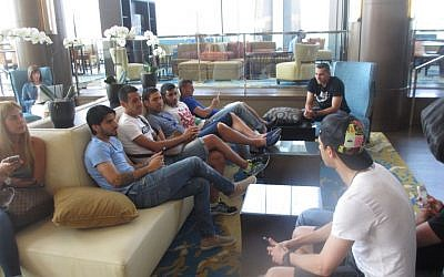 Israeli soccer players lounging at their hotel in New Jersey ahead of a match against Honduras. (photo credit: Howard Blas/Times of Israel staff)