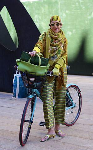 Tziporah Salamon tooling around on her bike -- without a  fashion faux pas helmet. (Courtesy of Ari Seth Cohen, advancedstyle.blogspot.com)