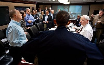 President Barack Obama talks with members of the his national security team in the White House Situation Room during one in a series of meetings to discuss the mission against Osama bin Laden, on May 1, 2011. (photo credit: AP Photo/The White House, Pete Souza, File)