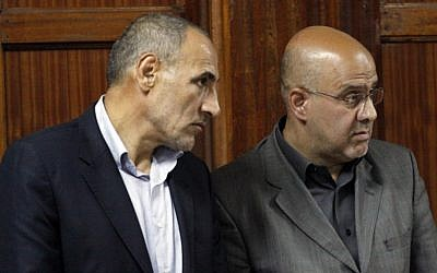 Iranian nationals Sayed Mansour Mousavi and Ahmad Abolfathi Mohammad await judgment at the magistrate's court in Nairobi, Kenya, on Monday. (photo credit: AP/Khalil Senosi)