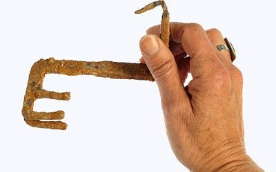 An iron key used to open a 2,000-year-old door, found in an ancient quarry in Jerusalem (photo credit: Clara Amit/Courtesy of the Israel Antiquities Authority)