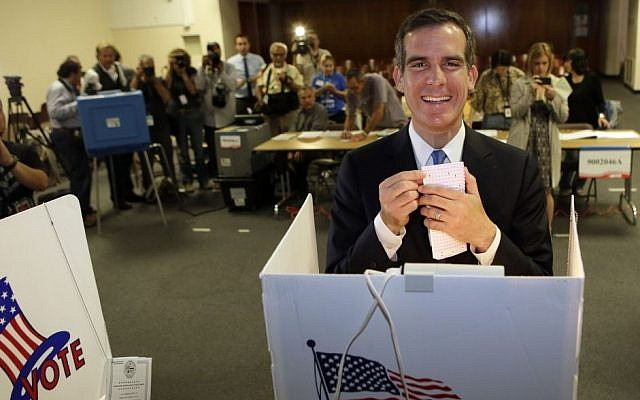 Los Angeles Mayoral candidate Eric Garcetti votes early Tuesday morning, May 21, 2013, in Los Angeles. (photo credit: AP Photo/Damian Dovarganes)