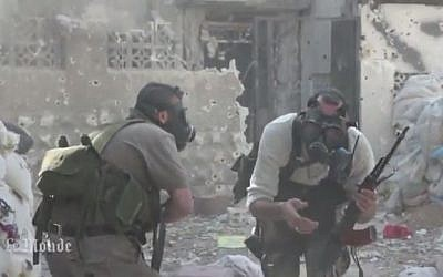 Syrian rebel fighters in gas masks against a chemical weapons attack, 2013. (screen capture: Youtube/MrMrAsi)