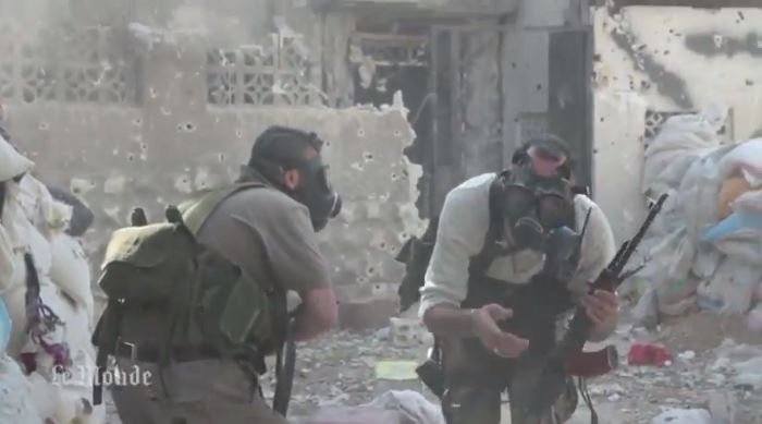 Syrian rebel fighters wearing gas masks against a chemical weapons attack earlier this year. (screen capture: Youtube/MrMrAsi)