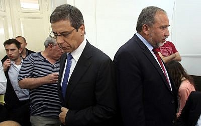 Danny Ayalon (right) and Avigdor Liberman in court Thursday. The two men, once close allies, did not speak (photo credit: Yossi Zamir/POOL/Flash90)
