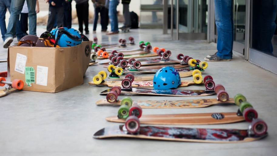 Longboards and helmets, courtesy of local skate shops, laid out for a Longboarding for Peace event last February (photo credit: Yohav Trudler)