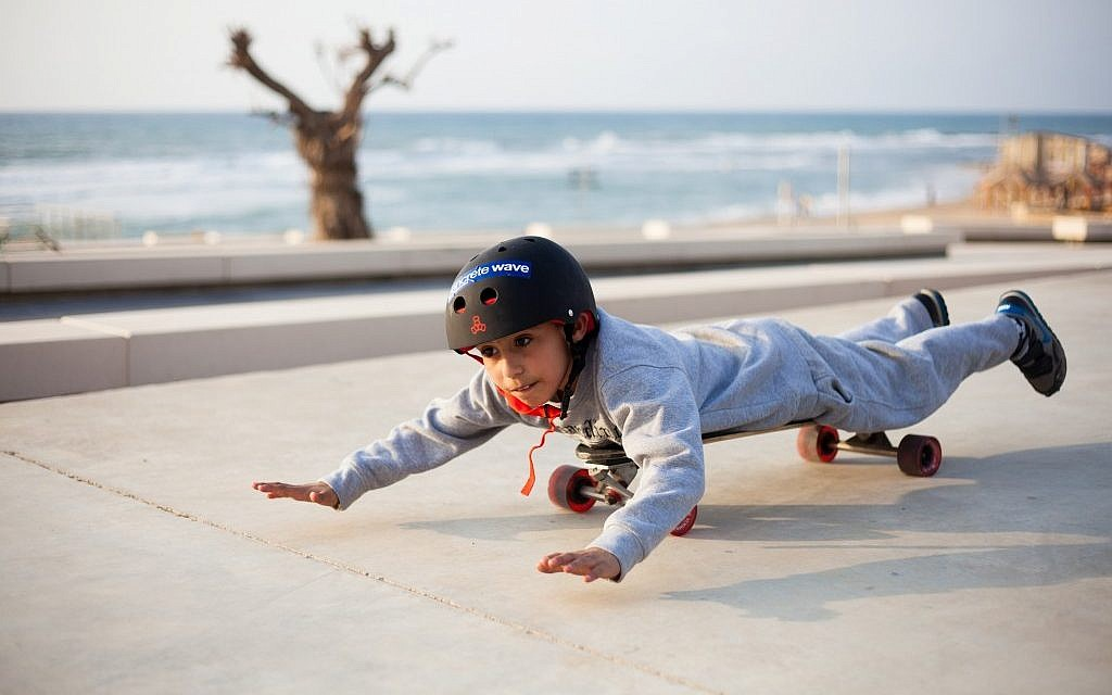 Taking a ride on a longboard at the Peres Center for Peace in Jaffa (photo credit: Yohav Trudler)
