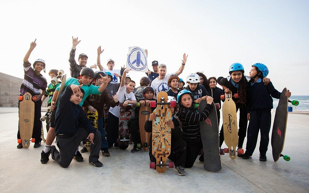 Arab and Jewish kids participate in a Longboarding for Peace event in Jaffa (photo credit: Yohav Trudler)