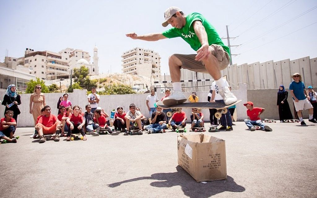 Yoni Ettinger demonstrates some tricks at the Shuafat refugee camp in East Jerusalem (photo credit: Yair Hasidof)