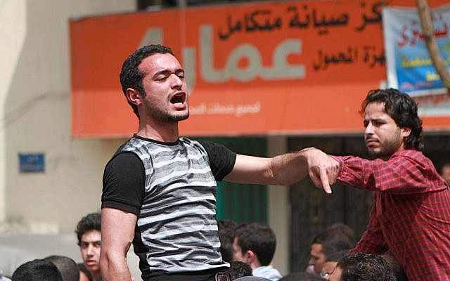This April 1, 2011 photo shows activist Ahmed Douma chanting slogans during a march to Tahrir Square demanding prosecution of members of former Egyptian president Hosni Mubarak's regime in Cairo, Egypt. (AP Photo/Sarah Carr)