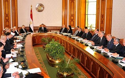 Mohammed Morsi, center, meets with his cabinet in Cairo, Egypt, Tuesday, May 7 (photo credit: AP /Egyptian Presidency)