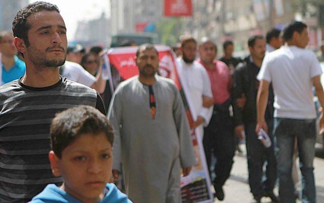 Activist Ahmed Douma, left, marching to Tahrir Square to demand prosecution of members of former president Hosni Mubarak's regime in Cairo, Egypt, April 1, 2011. (photo credit: AP/Sarah Carr)