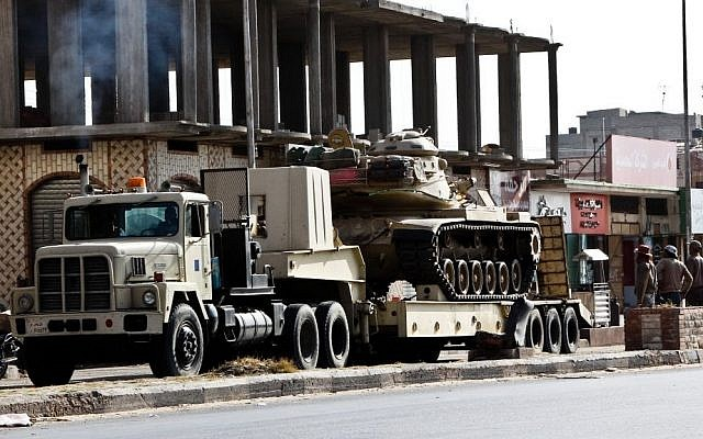 An Egyptian Army vehicle with a tank heads to the closed Rafah border crossing between Egypt and the Gaza strip, in Sheikh Zuweyid, northern Sinai, Egypt, Monday, May 20, 2013 (AP Photo/Roger Anis, El Shorouk Newspaper)
