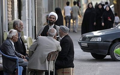 An Iranian clergyman talks with men in the eastern city of Birjand, Iran. (photo credit: AP/Vahid Salemi)