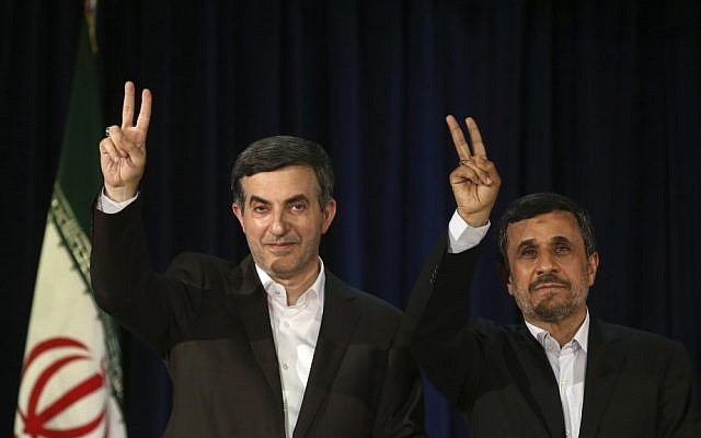 Mahmoud Ahmadinejad, right, and his close ally Esfandiar Rahim Mashaei, flash victory signs after registering Mashaei's candidacy  for presidential elections, in Tehran, Iran, on Saturday, May 11, 2013. (photo credit: AP/Ebrahim Noroozi)