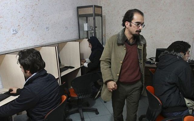 Iranians surf the web in an internet cafe in central Tehran, Iran, in Jan. 2011 (phto credit: AP/Vahid Salemi)