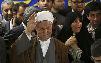 Former Iranian president Akbar Hashemi Rafsanjani waves as he registers his candidacy for the presidential election, May 11, 2013, before he was disqualified by the Guardian Council. (AP/Ebrahim Noroozi)