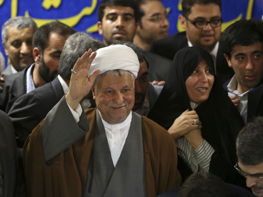 Former Iranian President Akbar Hashemi Rafsanjani waves as he registers his candidacy for the upcoming presidential election, May 11, 2013 (photo credit: AP/Ebrahim Noroozi)