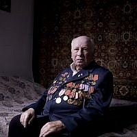 Soviet Jewish World War II veteran Matvey Gershman, 90, poses for a portrait at his house in the southern Israeli city of Ashkelon. Friday, April 12, 2013, (photo credit: AP/Oded Balilty)