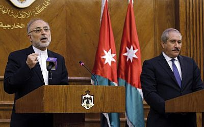 In this Tuesday, May 7, 2013 file photo, Iranian Foreign Minister Ali Akbar Salehi, left, speaks at a joint news conference as his Jordanian counterpart, Naser Judeh, listens in Amman, Jordan. Salehi wrote in an opinion piece in the Lebanese daily Al-Akhbar Wednesday, May 8, that it is up to the Syrian people to choose their political system and president, suggesting Tehran is not wedded to Assad's continued rule. (Photo credit: AP/Raad Adayleh)