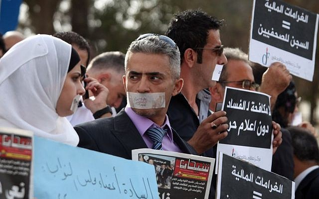 File: Jordanian journalists protest in front of the country's Parliament in Amman in 2011 over changes to the country's anti-corruption laws that they claimed muzzled press freedoms in the kingdom. (AP Photo/Mohammad Hannon)