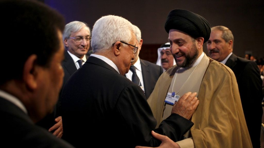 Palestinian Authority President Mahmoud Abbas, left, greets Ammar al-Hakim, head of the Supreme Islamic Council of Iraq, at the World Economic Forum in Jordan on Saturday. (photo credit: AP Photo/Mohammad Hannon)