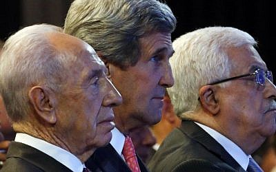 US Secretary of State John Kerry, Israeli President Shimon Peres, left, and Palestinian President Mahmoud Abbas, right, participate in the World Economic Forum on the Middle East and North Africa at the King Hussein Convention Center at the Dead Sea in Jordan Sunday May 26, 2013. (photo credit: AP/ Jim Young)