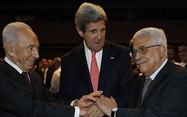 US Secretary of State John Kerry (center), Israeli President Shimon Peres (left), and Palestinian Authority President Mahmoud Abbas shake hands during the World Economic Forum in Jordan, Sunday May 26, 2013. (photo credit: AP/Jim Young)