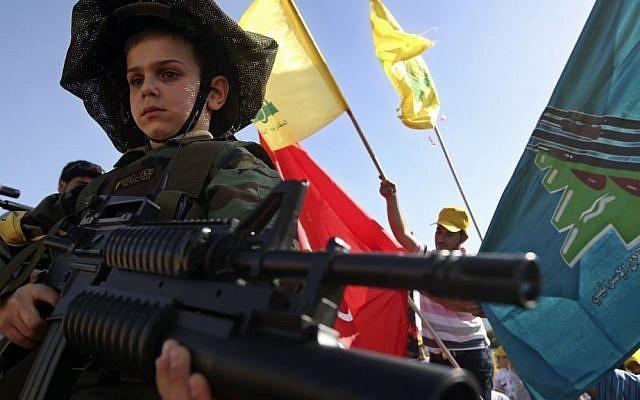 A Lebanese boy at a Hezbollah rally in Lebanon in May.  (photo credit: AP/Hussein Malla)